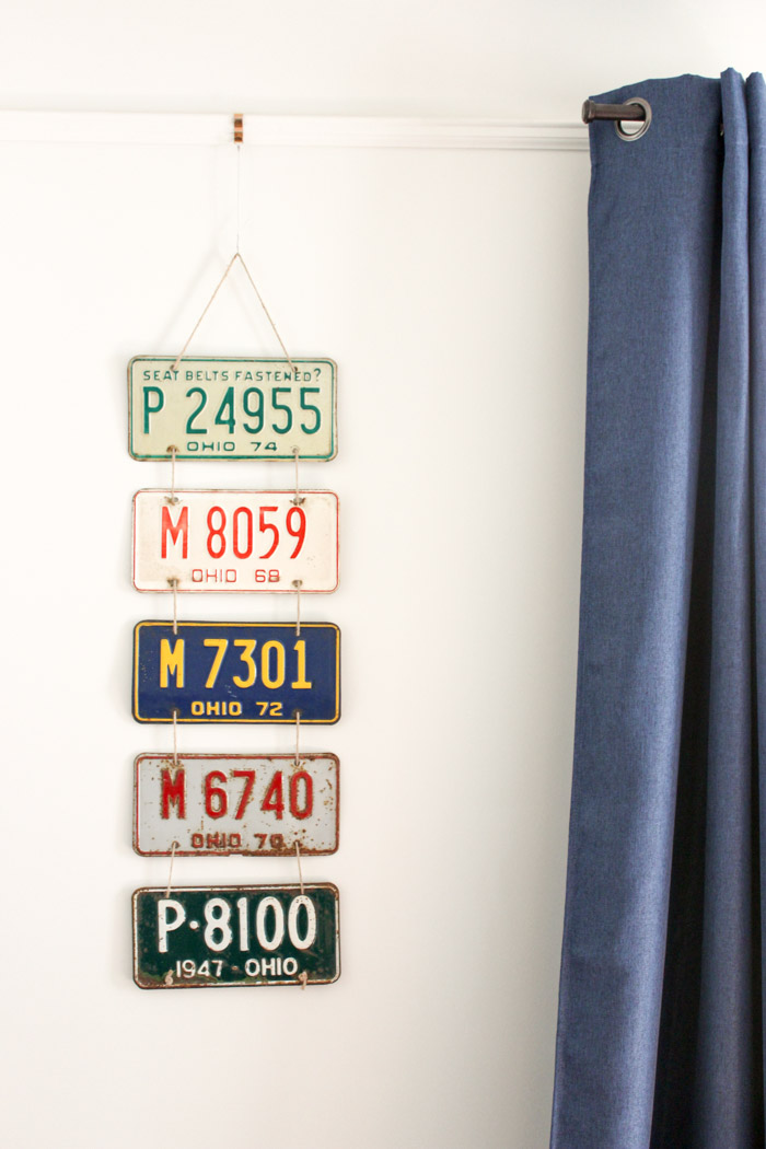 license plate wall decor with blue curtain