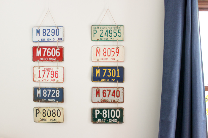 license plates hanging on wall