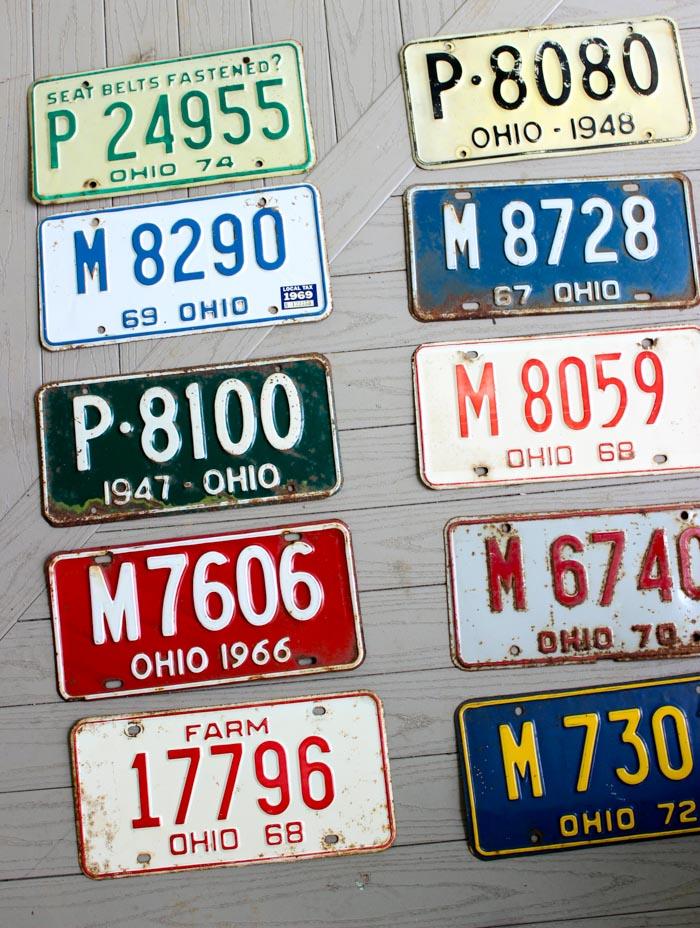 ten license plates on porch floor