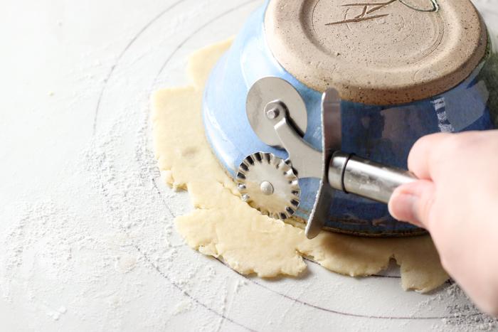 trimming around the pie dough to make pie topper