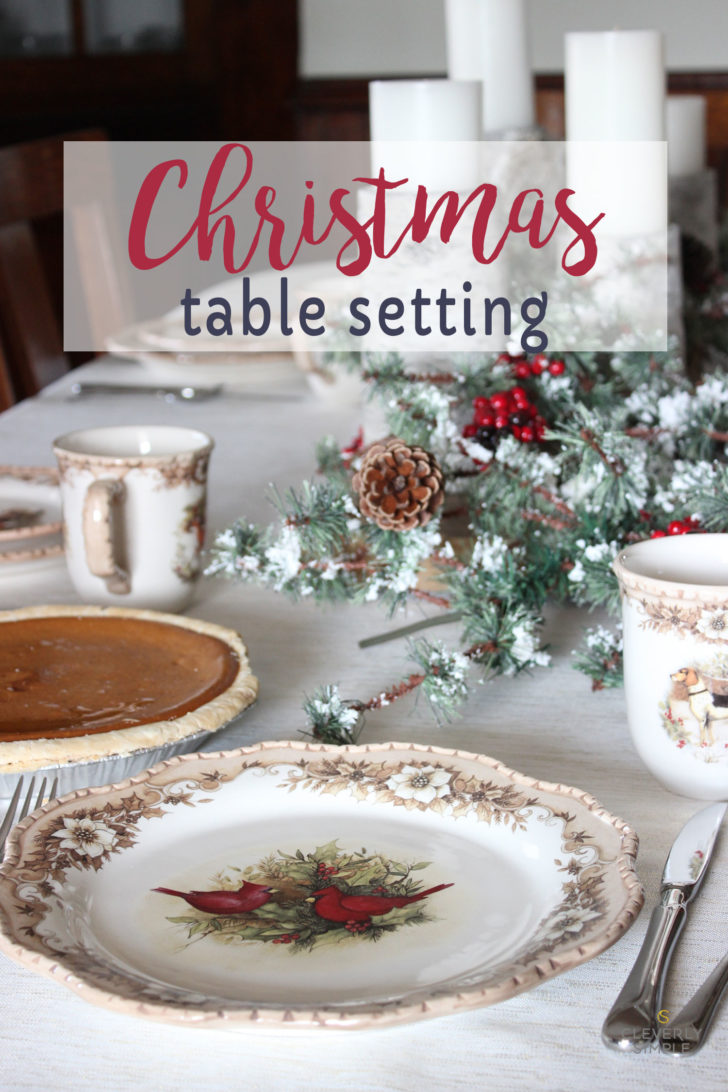 Christmas table setting with barn wood, holly, owl and candles. Paired with Cracker Barrel table setting.