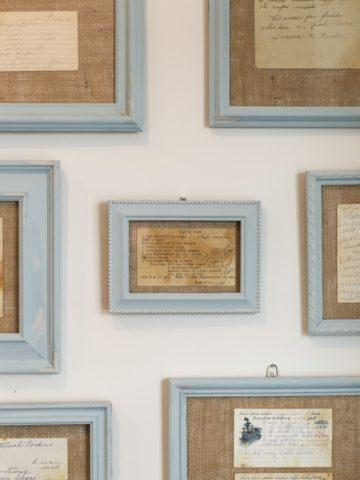 framed recipe cards on wall