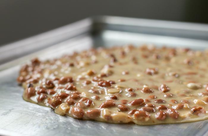 Peanut brittle spread onto pan