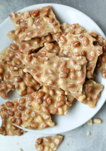 peanut brittle broken on plate