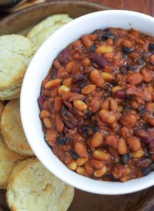 baked beans in bowl with side of biscuits