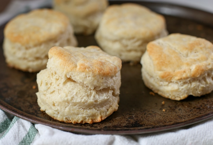 baked homemade biscuits on dark pan