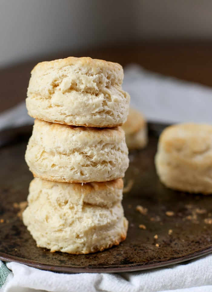 stack of homemade biscuits on baking pan