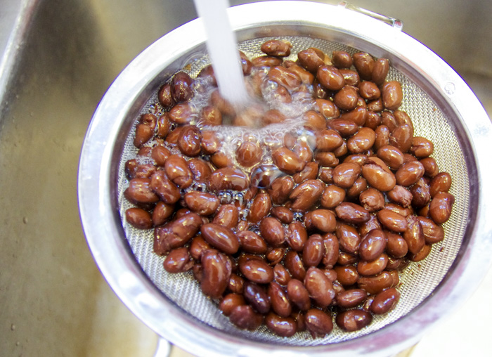 beans being rinsed in water