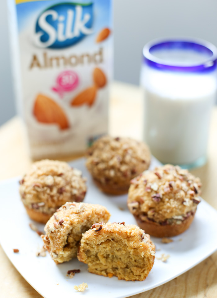 Silk Almondmilk in glass with plate of sweet potato muffins