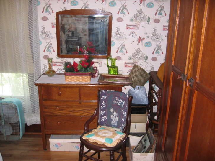 room with chair dresser and mirror
