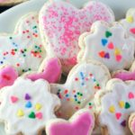 plate of sugar cookies with icing and sprinkles