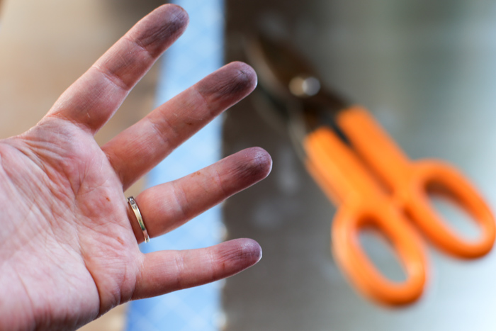 oily hand from galvanized metal