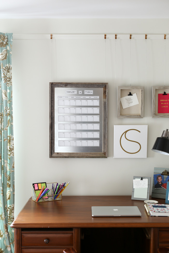 framed calendar on wall with desk