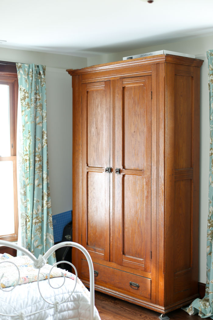 large antique armoire in room