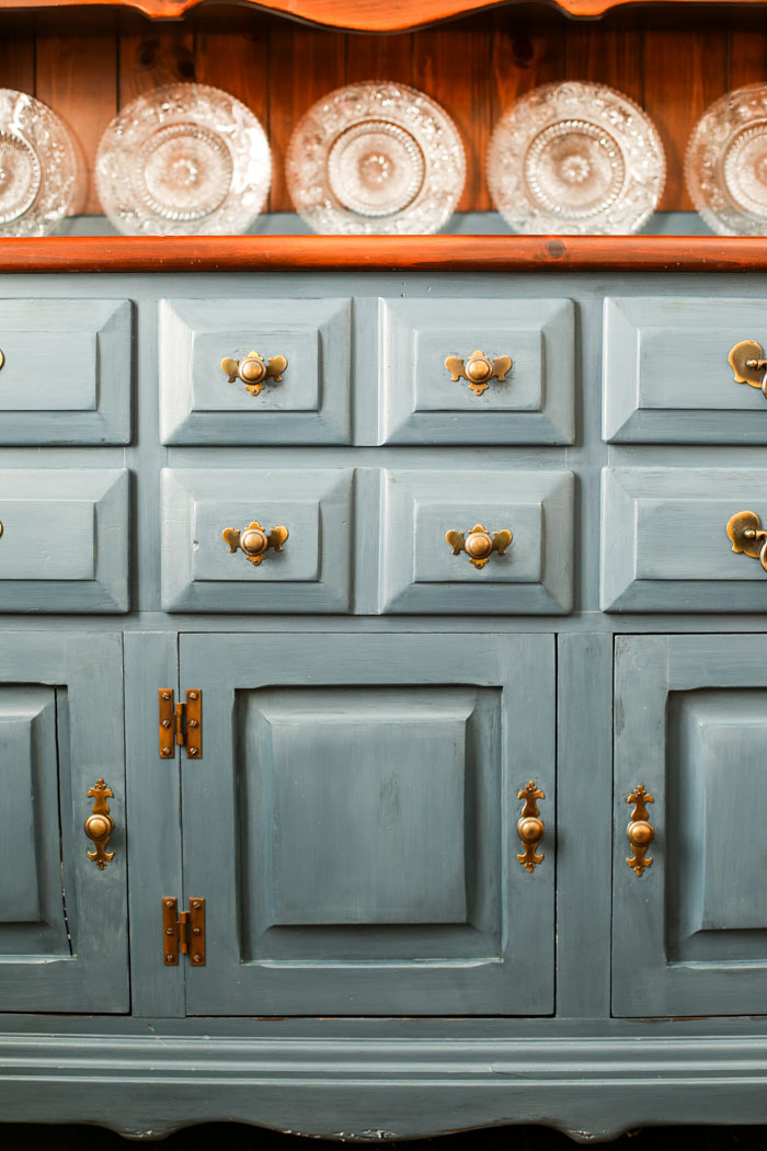 painted dining room hutch with brass knobs