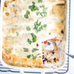 slice of chicken enchiladas out of pan