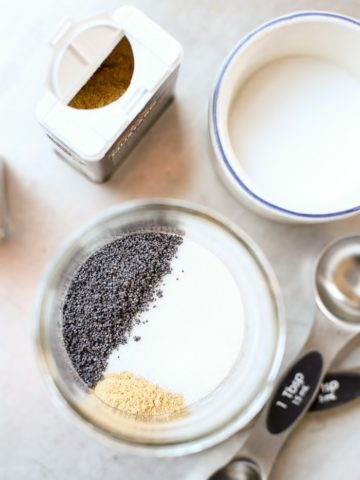 ingredients for poppyseed dressing in mason jar