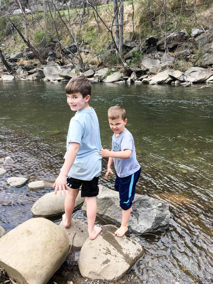 Two boys in creek at Gatlinburg