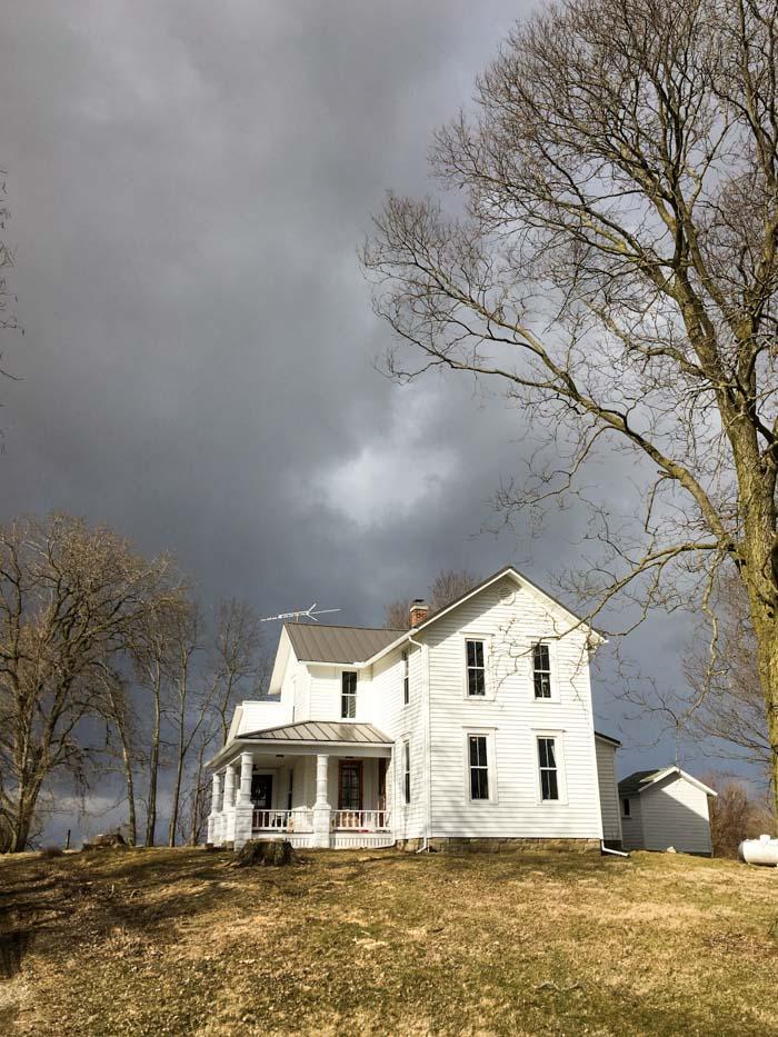 old farmhouse on hill