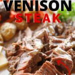 venison steak on plate with side dishes