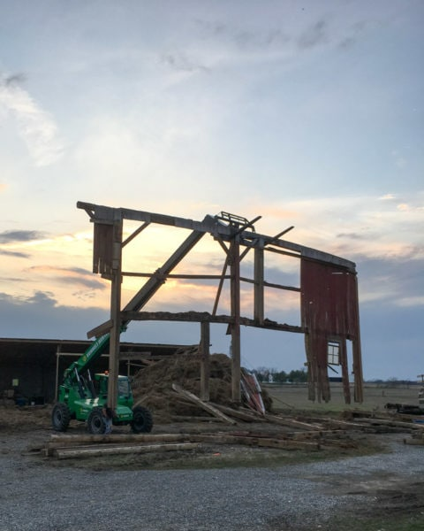 barn piece being removed