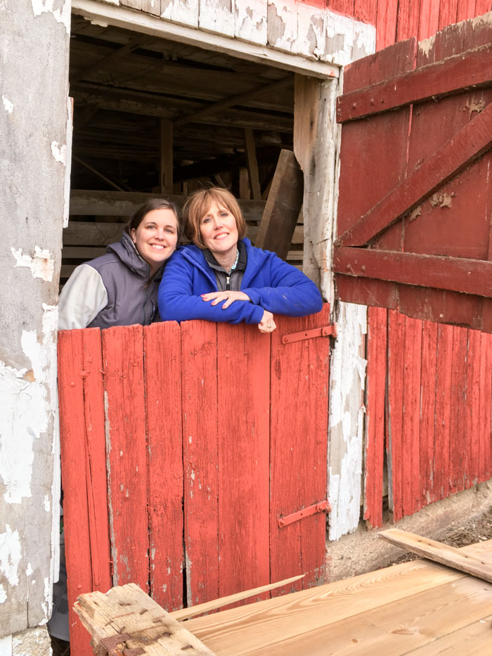 mom and daughter in barn