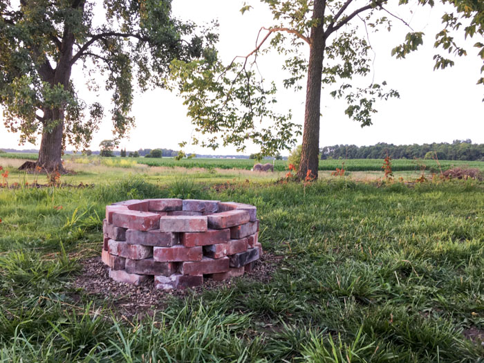 brick fire pit in back yard