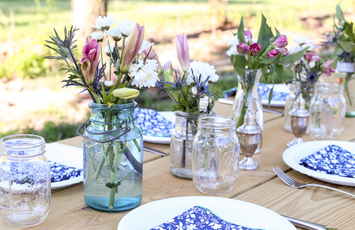 flower centerpieces on table for outdoor entertaining