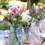 ball jars with flowers on picnic table