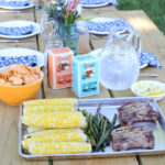 picnic table in backyard with dinner
