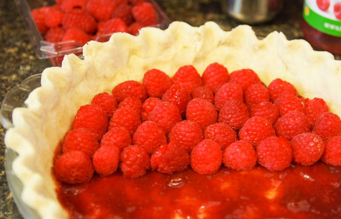 fresh raspberries on pie shell for pear pie filling recipe