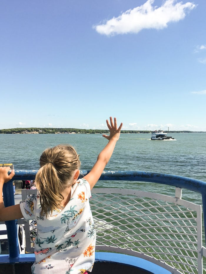 girl waving to miller ferry
