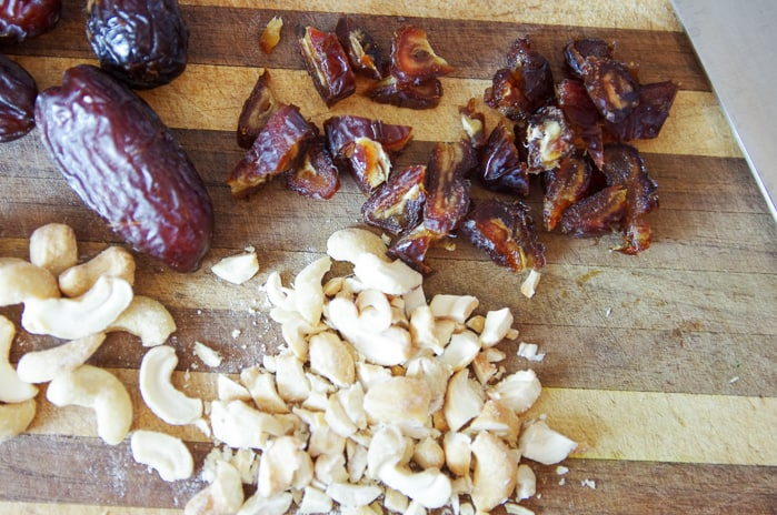 dates and cashews for healthy zucchini bread recipe on cutting board