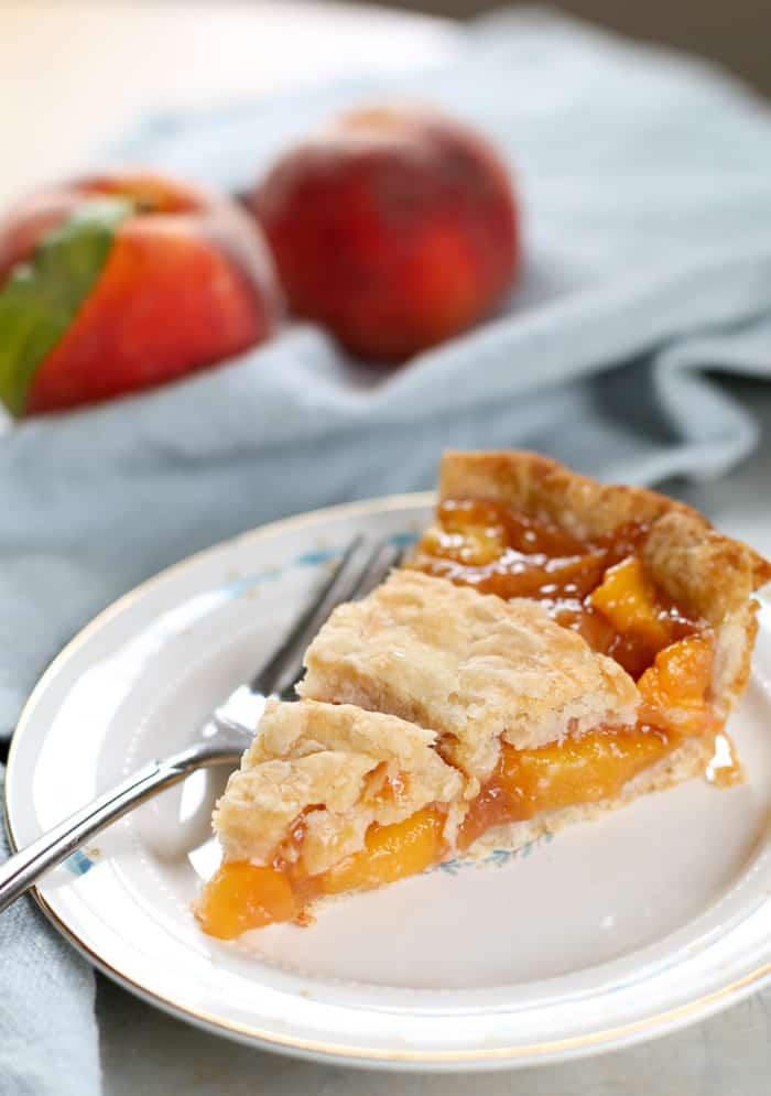 fresh peach pie on plate