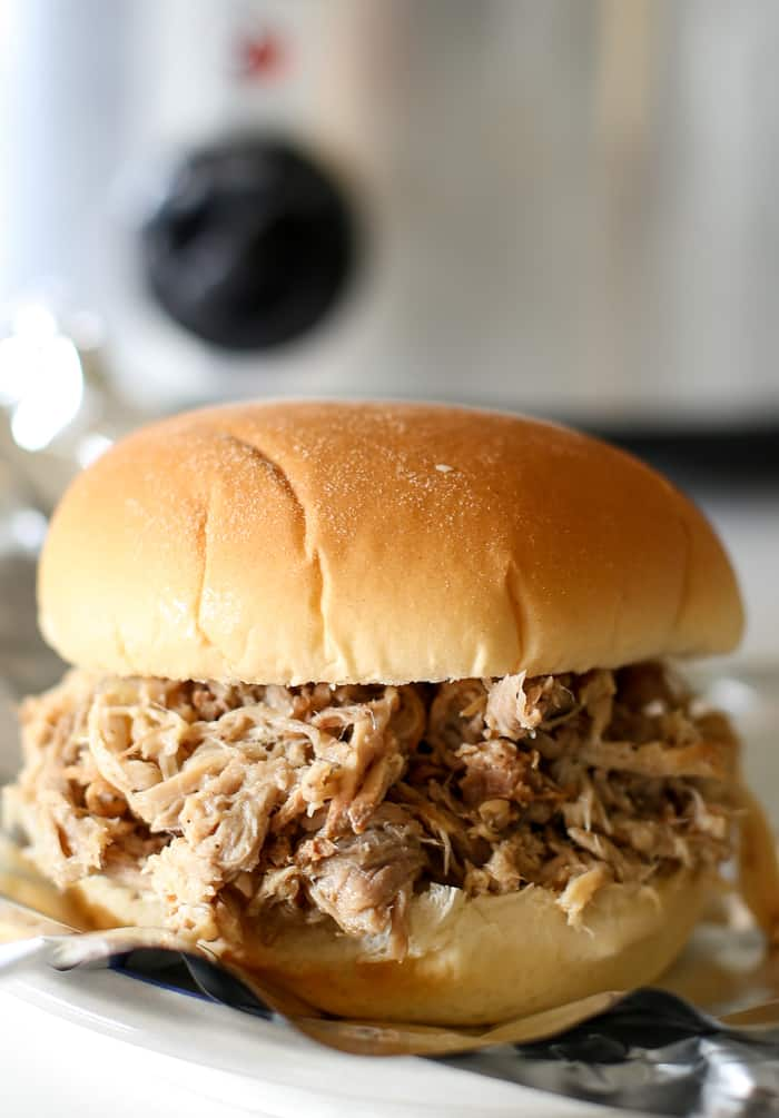 The very BEST slow cooker pulled pork. Seriously, this recipe is easy! Prepped in minutes and cooked to moist perfection. Top with your favorite bbq sauce. #slowcooker #crockpot #pork
