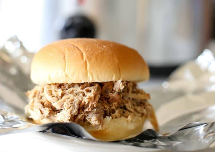 Easy pulled pork slow cooker recipe in bun on plate