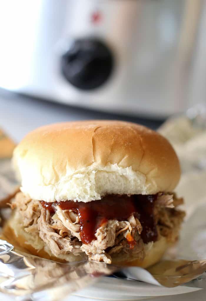bbq sauce on pulled pork sandwich