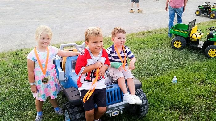kids on toy car