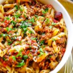 slow cooker eggplant pasta with sausage in bowl
