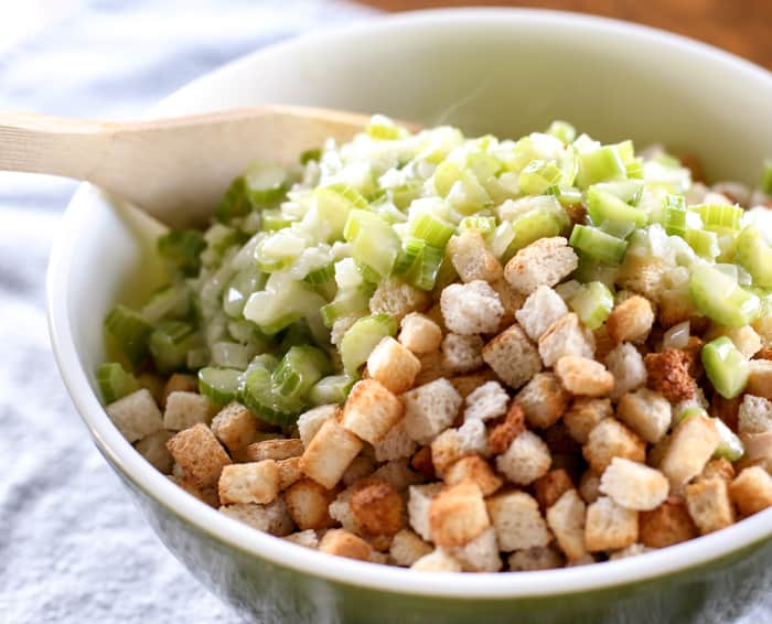 bread cubes and celery in bowl for homemade stuffing