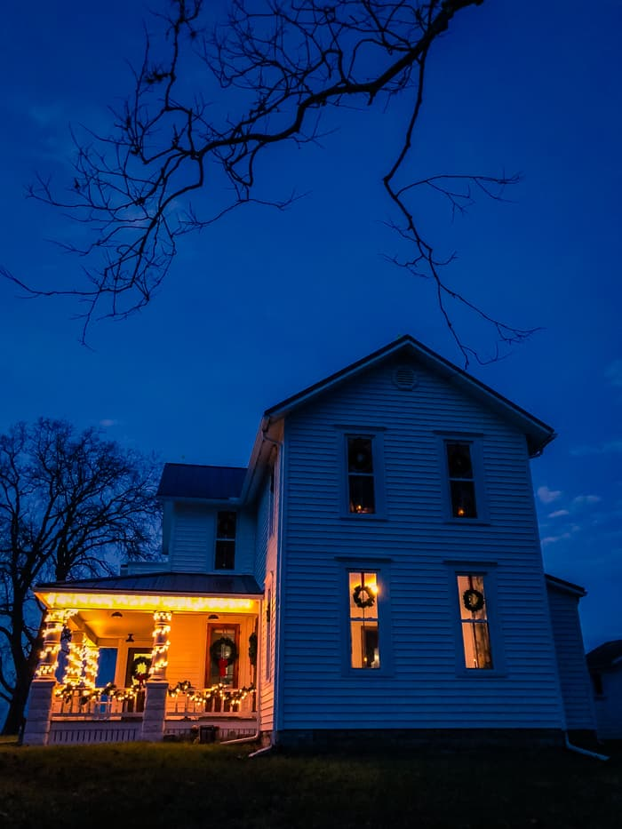 farmhouse with christmas lights