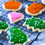 sugar cookies with icing on cooling rack