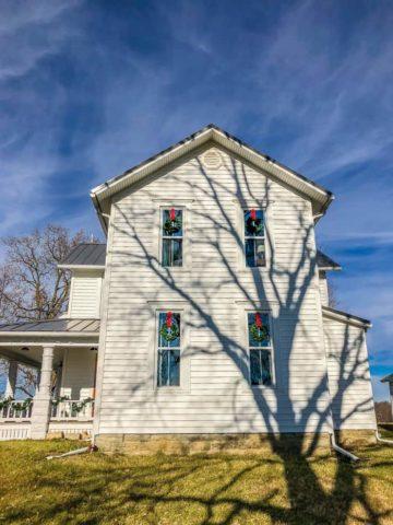 farmhouse with wreaths