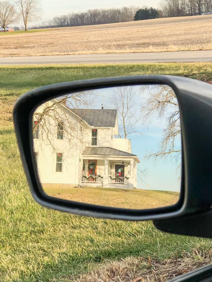 farmhouse in rearview mirror