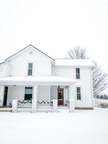 farmhouse in snow