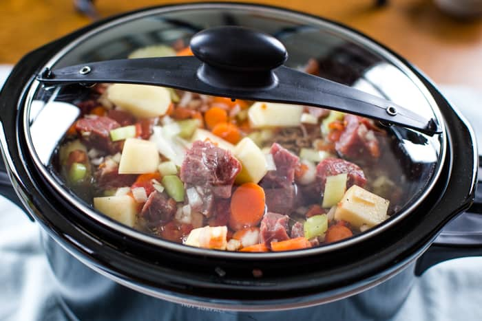 slow cooker full of vegetable beef soup