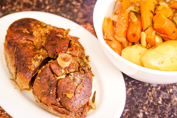 roast on plate with carrots and potatoes