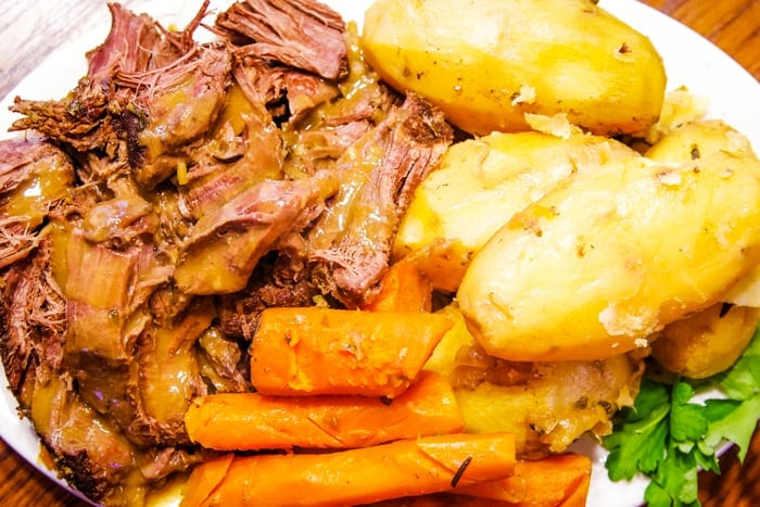 plate of venison roast deer roast with carrots and potatoes
