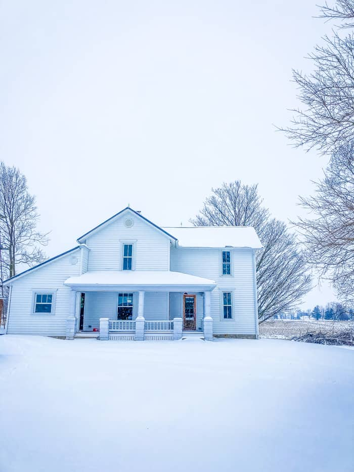 snow on farmhouse