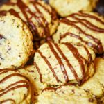 healthy oatmeal cookies drizzled with chocolate on a plate